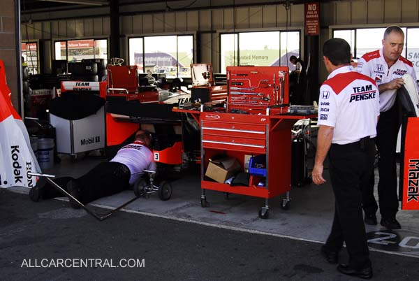 Helio Castroneves Crew working to replace Helio's car after fire